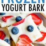 Squares of frozen yogurt berry bark on a plate.