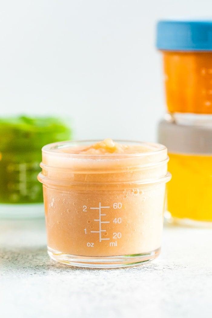 Peach pear baby food in a 4 oz baby food jar.