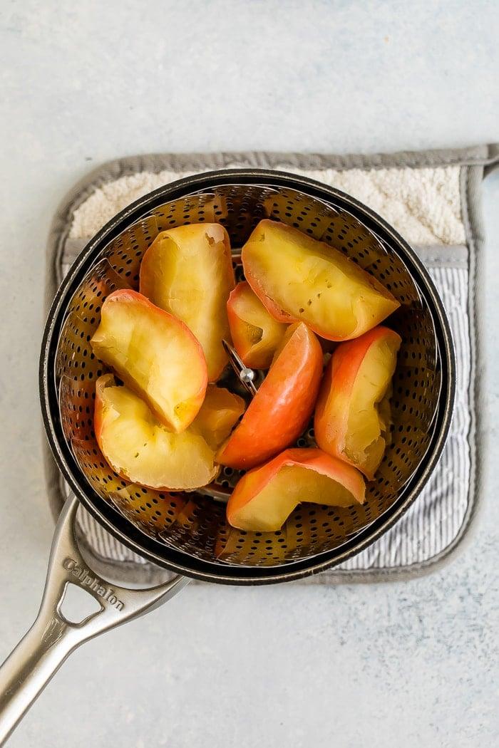 Steamed apples in a steamer basket