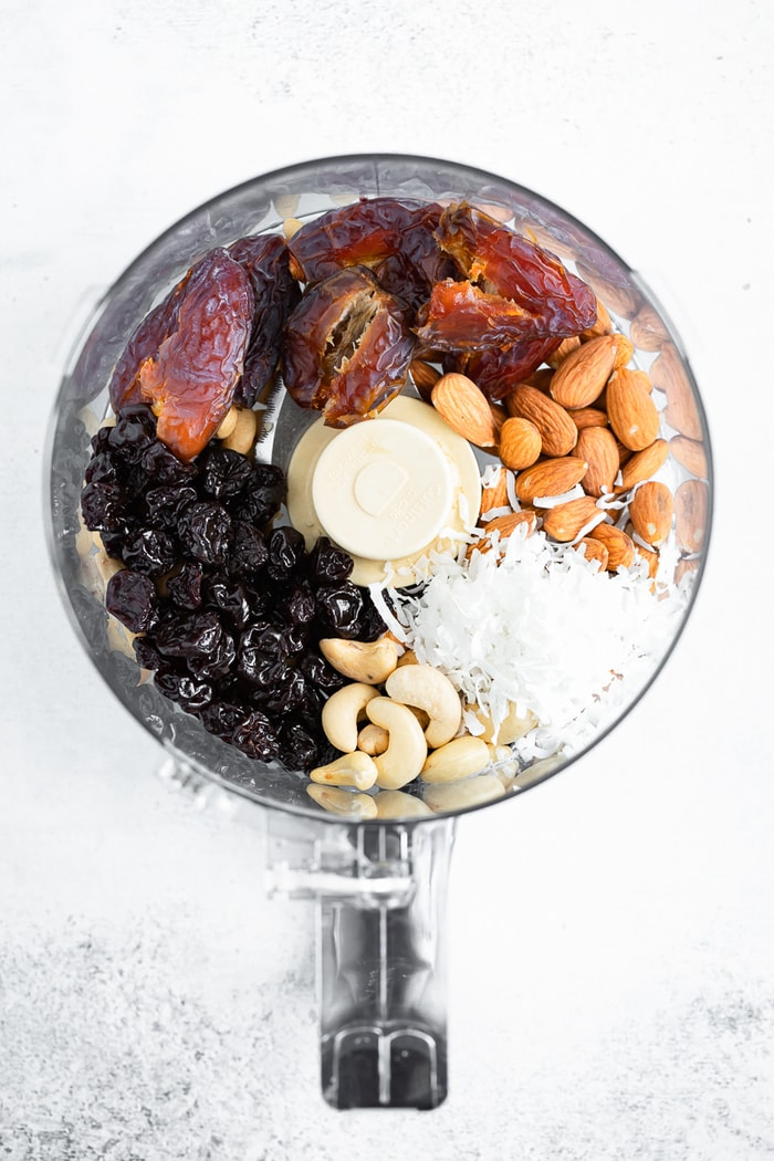 Ingredients for Cherry Energy Bites in a food processor.