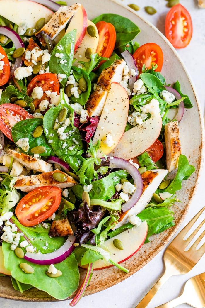 Fuji apple chicken salad with gorgonzola cheese, pepitas, tomatoes and dressing.