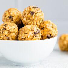 White bowl full of peanut butter chocolate chip energy balls.