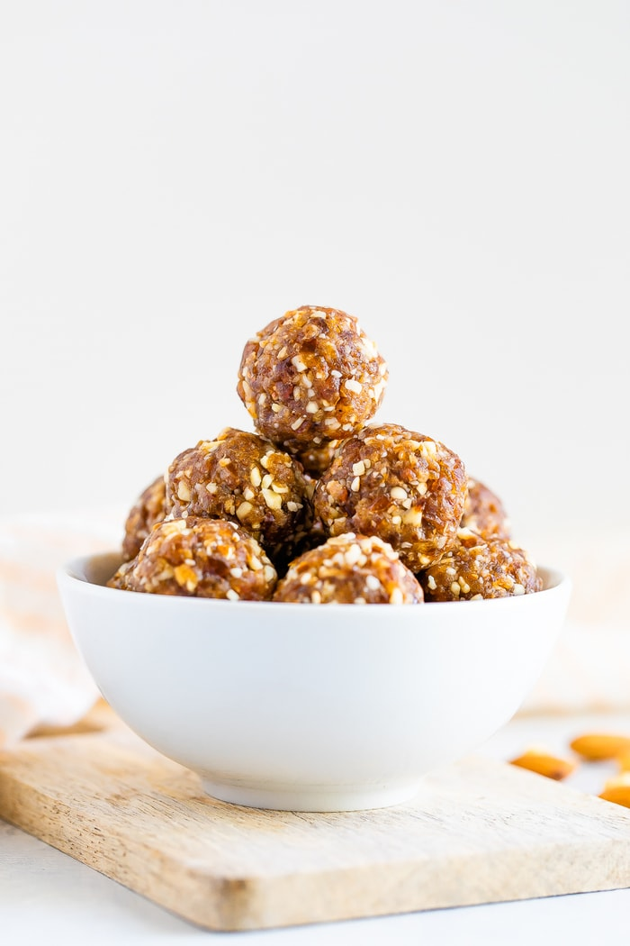 Straight on shot of pumpkin pie energy balls in a white bowl.