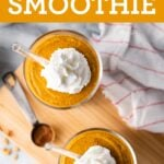 Two glasses of pumpkin pie smoothies topped with whipped cream.