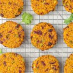 Sweet potato quinoa cakes on a wire rack.