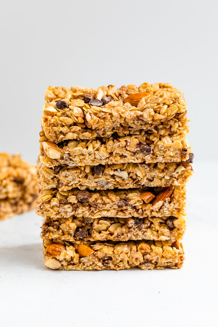 A neat stack of 6 chocolate chip almond granola bars.