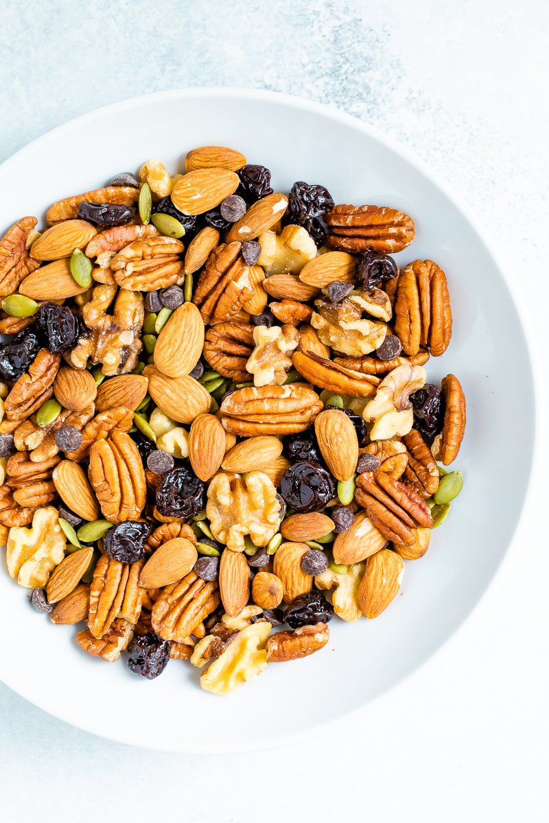 Bowl of trail mix with nuts, seeds and fruit.