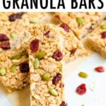 Pumpkin spice granola bars propped up on each other and made with cranberries and pepitas.