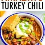 Bowl of turkey chili with sour cream, avocado and cornbread.