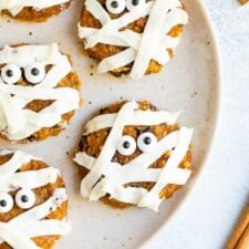 Plate with cute pumpkin mummy decorated cookies.