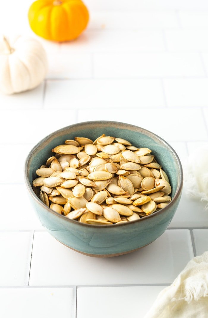 Bowl of roasted pumpkin seeds.