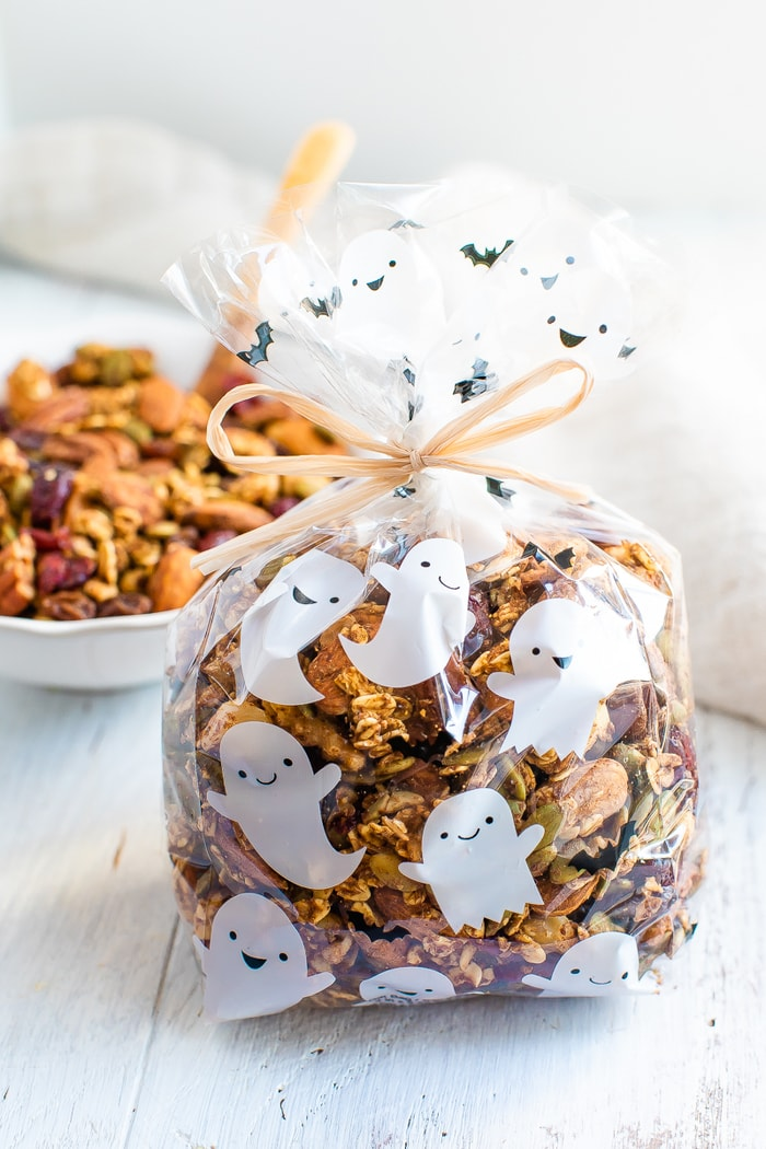 Cute ghost treat bag filled with pumpkin spice trail mix and tied with a bow.