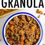 Bowl of quinoa granola tossed with nuts, dried fruit and chocolate chips.