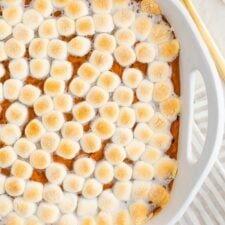 Sweet potato casserole topped with marshmallows.
