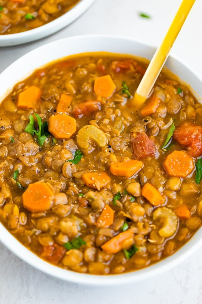 Bowl of lentil soup with celery and carrots.