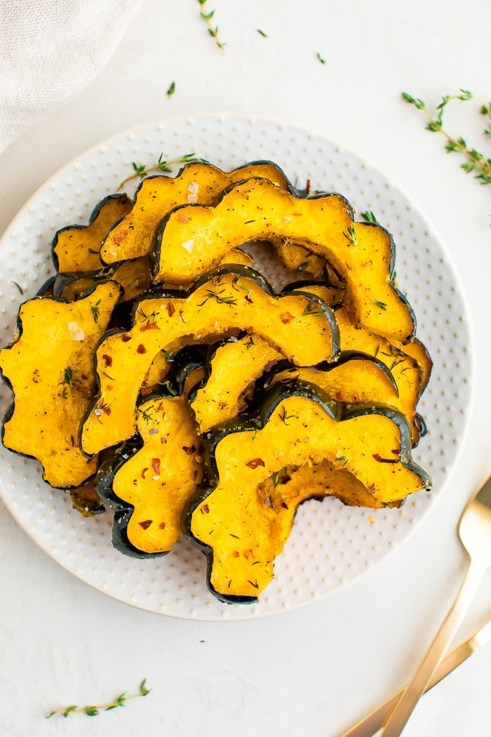 Slice of roasted acorn squash with spices on it.