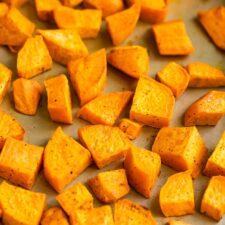 Sheet pan with roasted sweet potatoes.