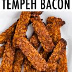 Crispy tempeh bacon on a plate.