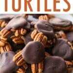 Close up photo of homemade turtle candies made with pecans, date caramel and chocolate.