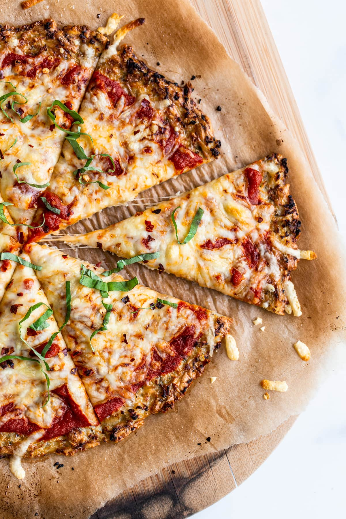 Cauliflower pizza cut into slices.