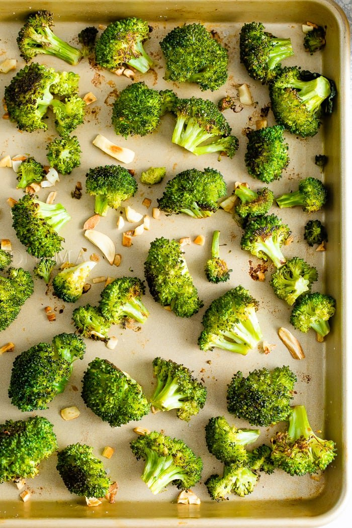 Sheet pan with roasted broccoli and garlic.