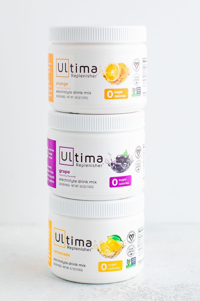 Three jars of Ultima Electrolyte Drink Mix.