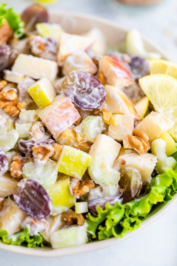 Waldorf salad served in a bowl over lettuce.
