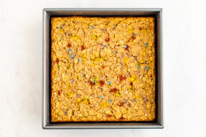 Square baking pan with baked birthday cake oatmeal.