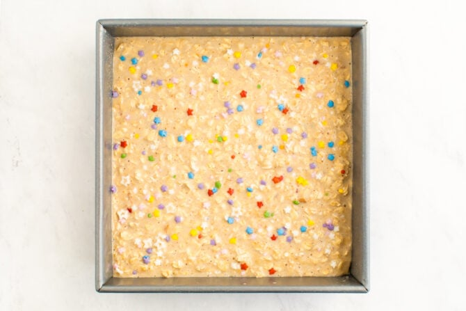 Square pan with batter for birthday cake oatmeal.