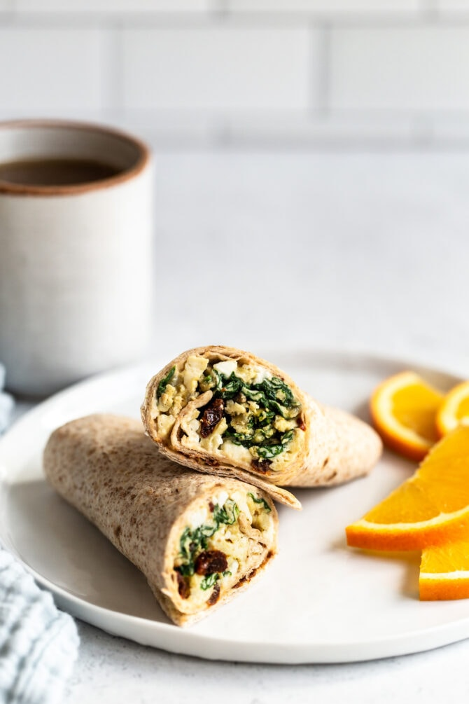 High protein spinach veggie wrap served on a plate.