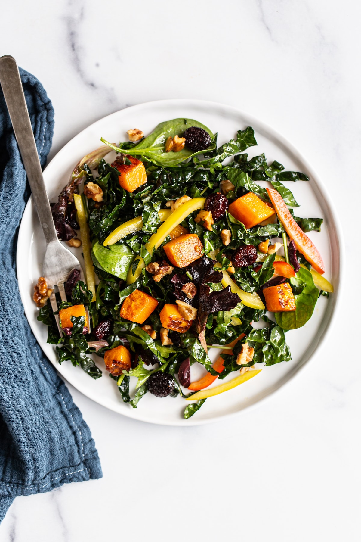 Plate with butternut squash and kale salad.