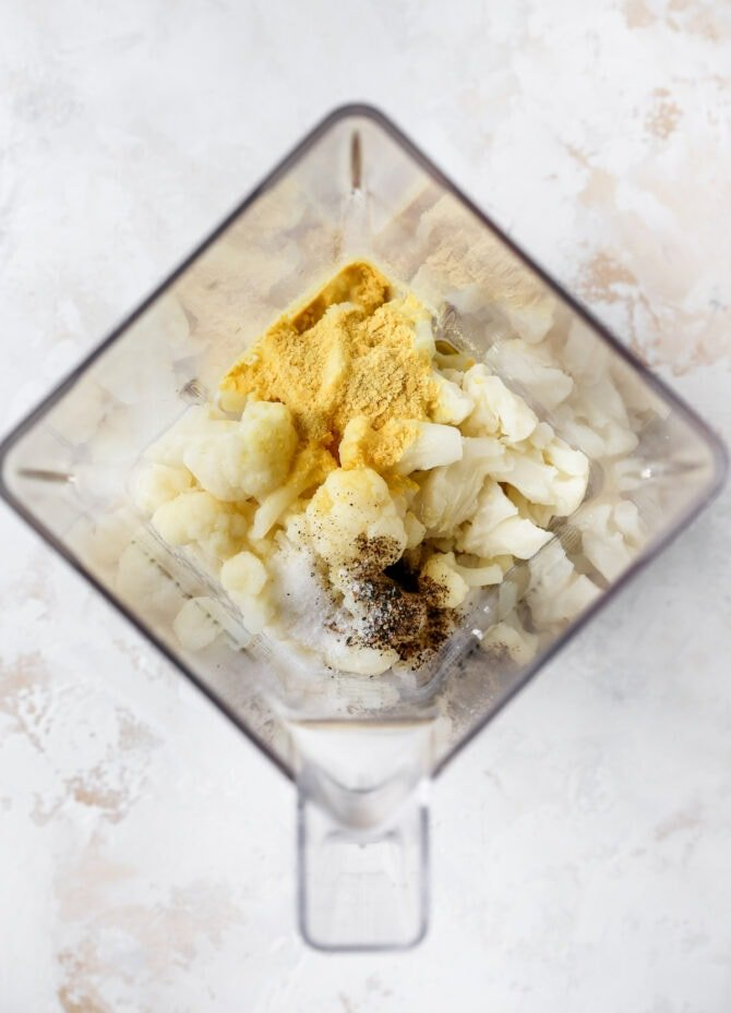 Cauliflower and spices in a blender.