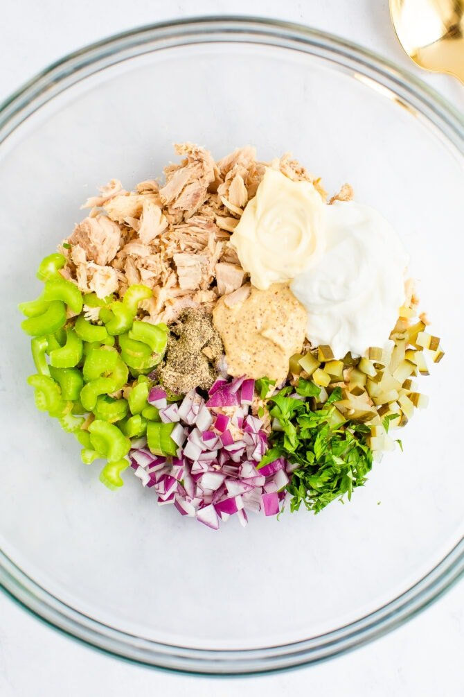 Mixing bowl with ingredients to make tuna salad.