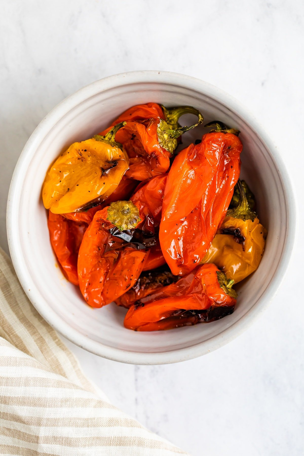 Roasted peppers in a bowl.