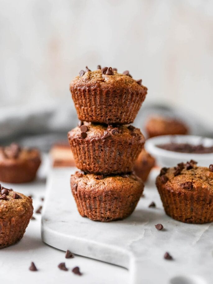 Stack of three almond flour chocolate chip muffins.