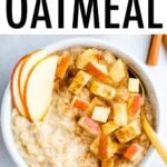 Bowl of oatmeal topped with cinnamon and apples.