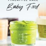 Jar of homemade avocado peach pineapple kale baby food.