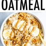 Bowl of oatmeal topped with bananas, walnuts and peanut butter.