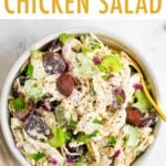 Bowl of chicken salad with grapes and celery.