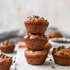 Stack of three chocolate chip almond flour muffins.