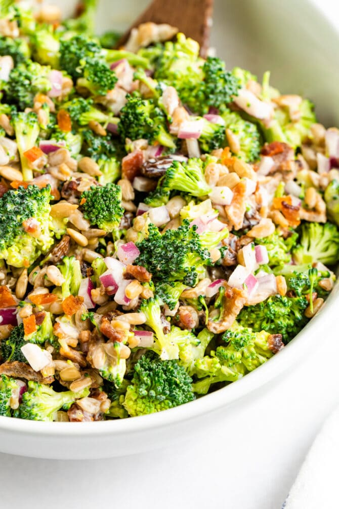 Bowl of classic broccoli salad.