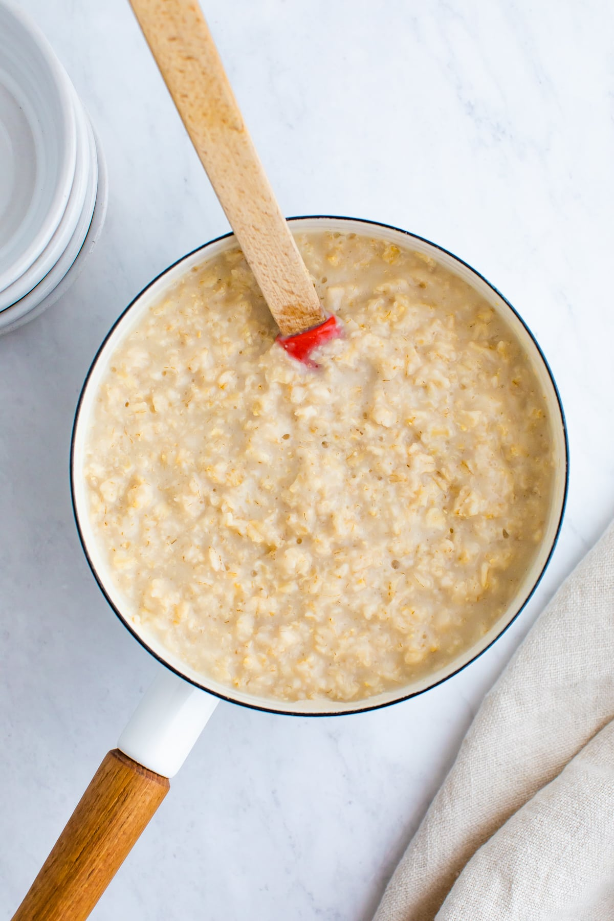 Pot with oatmeal and a spoon.