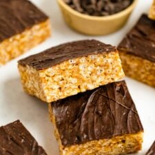 Two rice krispie treats topped with a layer of chocolate.