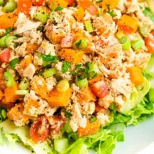 Close up photo of sweet potato tuna salad served on a bed of lettuce.