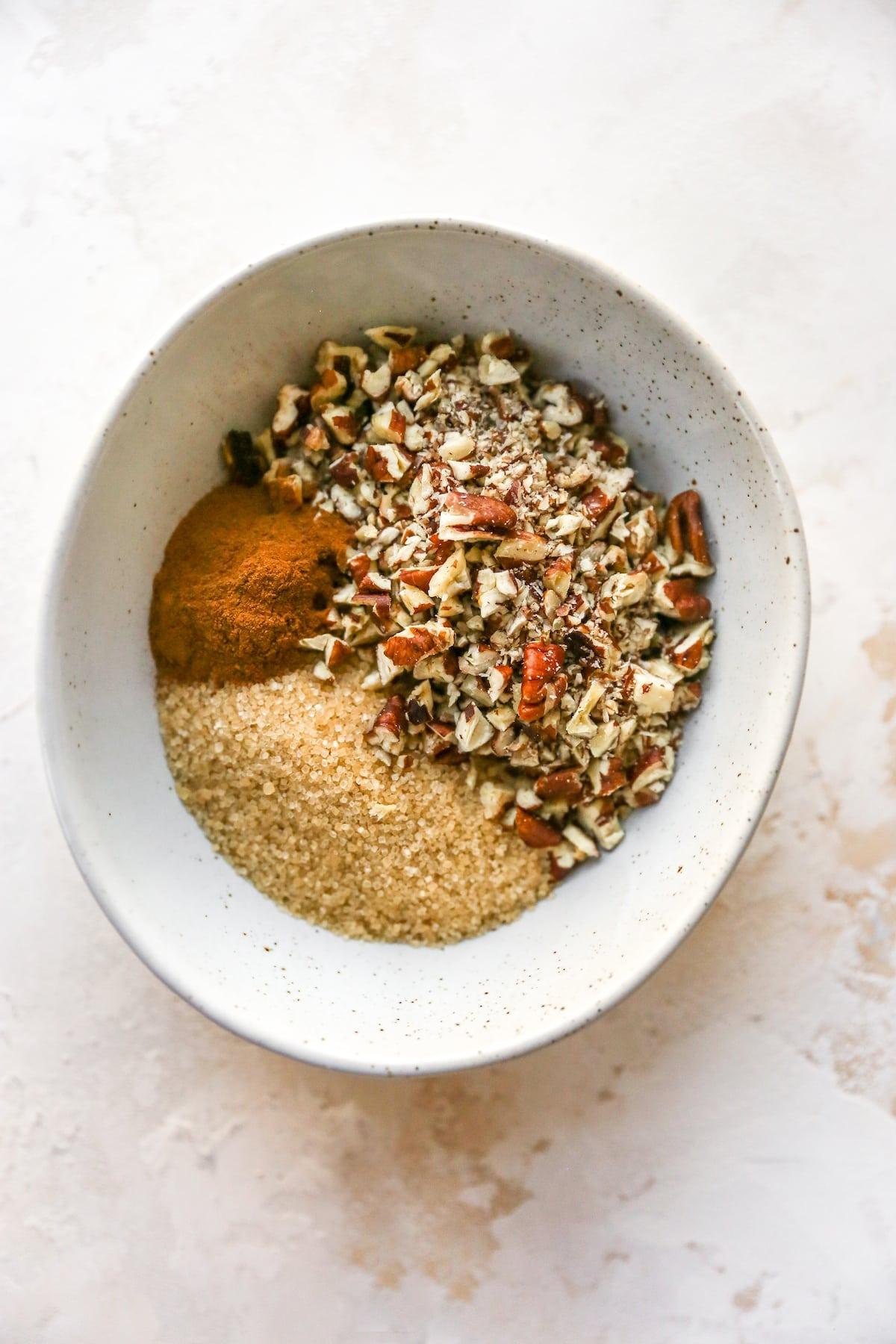 Bowl of cinnamon, sugar and pecans.