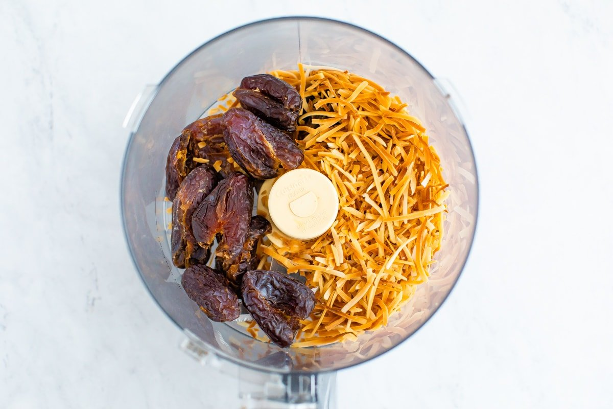 Food processor of dates and toasted coconut.