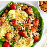 Spinach salad with avocado, strawberries, pecans, goat cheese and balsamic dressing.