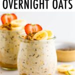 Two jars of overnight oats. The bottom as peanut butter and it's topped with fruit and granola.