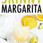 Glass with a margarita garnished with lime orange slices.