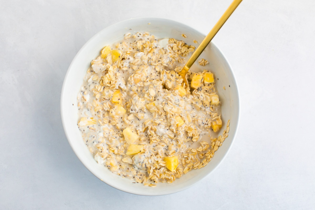 Mixed tropical overnight oats in a bowl.